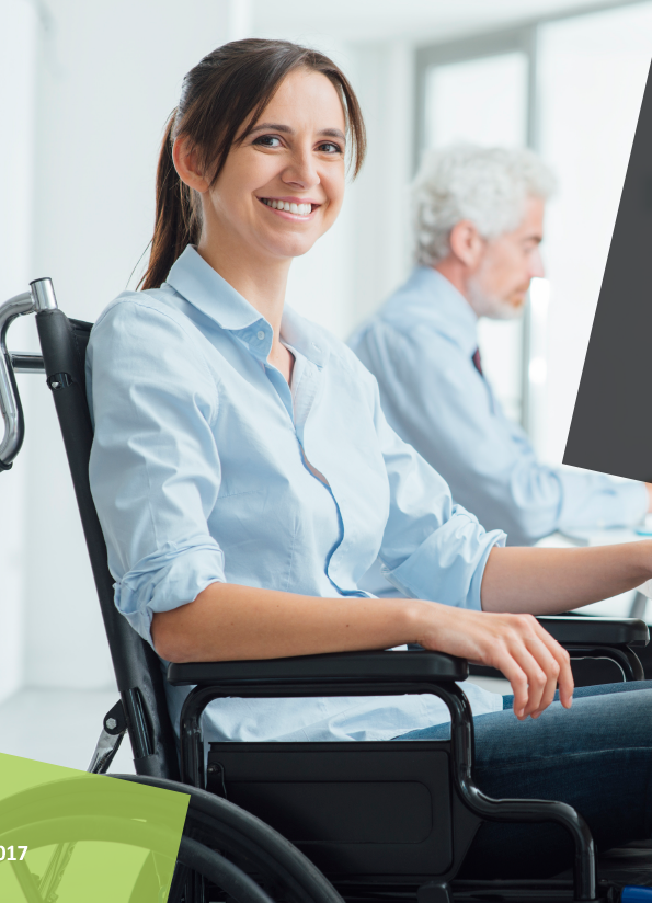 Cover of the Implementation Guide showing a woman in a wheelchair at work smiling at camera
